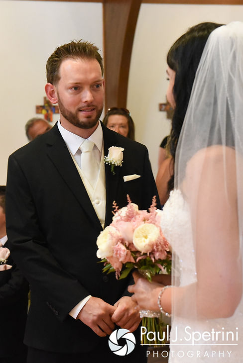 Justin looks at Lauryn during their July 2016 wedding at St. Paul the Apostle Catholic Church in Foster, Rhode Island.