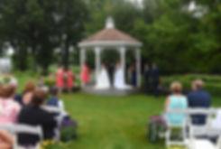 Laura and Marijke listen during their June 2018 wedding ceremony at Independence Harbor in Assonet, Massachusetts.