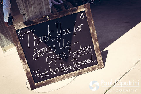 A look at a sign for guests at the ceremony site for Krystal and Ian's May 2016 wedding at Colt State Park in Bristol, Rhode Island.