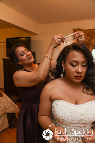 Stephany has her veil put on prior to her September 2017 wedding ceremony at Wannamoisett Country Club in Rumford, Rhode Island.