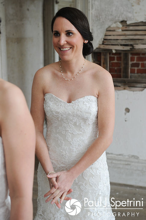 Caroline smiles for a photo before her April wedding ceremony at the Fort Adams Trust in Newport, Rhode Island.