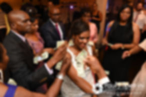 Kemi is showered with money during her August 2016 wedding reception at the Villa at Riddler Country Club in East Bridgewater, Massachusetts.