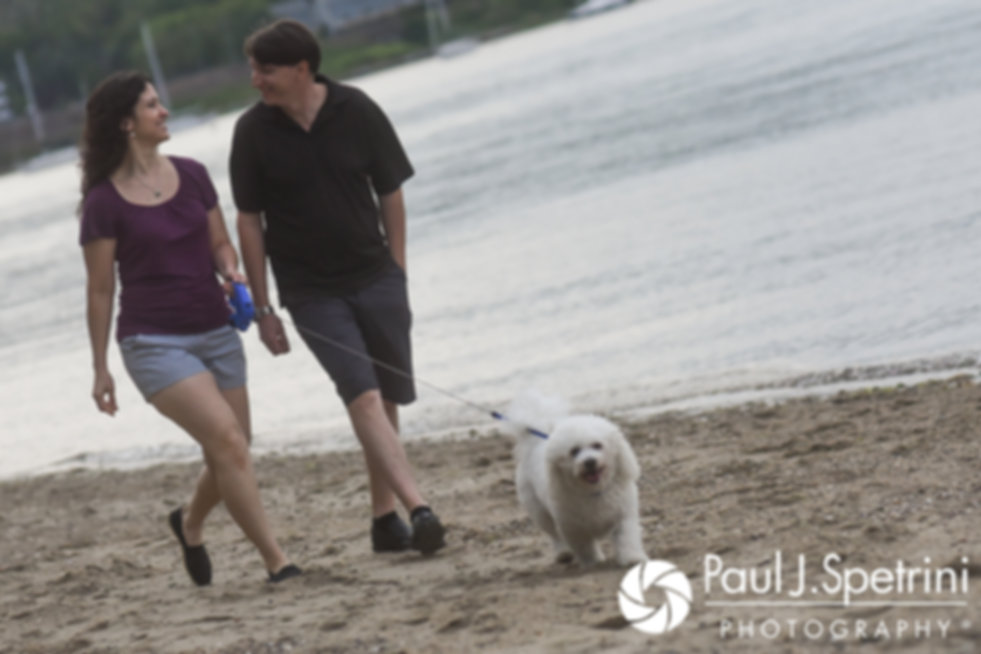 Amanda and Josh walk with their dog Odie at Goddard Park in East Greenwich, Rhode Island during their May 2017 engagement photo session.