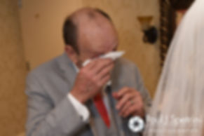 Michelle's father sheds a tear after seeing her in her wedding dress for the first time prior to her May 2016 wedding at Hillside Country Club in Rehoboth, Massachusetts.