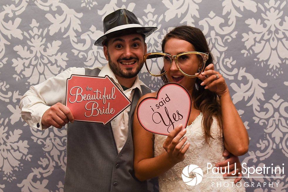Stacey and John pose for a photo in their photo booth during their September 2017 wedding reception in Warren, Rhode Island.