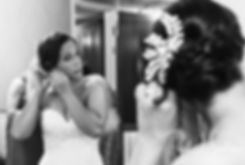 Danielle puts earrings on prior to her August 2018 wedding ceremony at the Roger Williams Park Casino in Providence, Rhode Island.