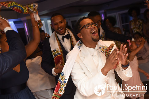 Luis celebrates during his June 2017 wedding reception at Al's Waterfront Restaurant in East Providence, Rhode Island.