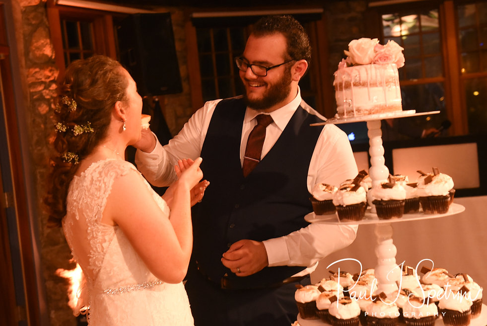 Rob & Allie feed each other their wedding cake during their October 2018 wedding reception at The Towers in Narragansett, Rhode Island.