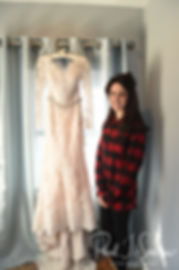 Stacey poses for a photo near her dress during her bridal prep session at in Attleboro, Massachusetts.