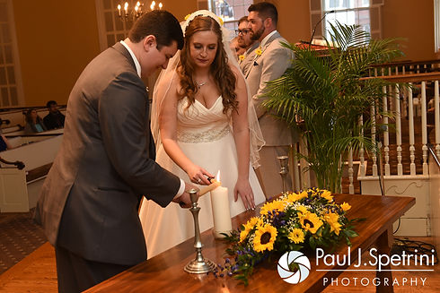 Kristin and Chris light a unity candle during their October 2016 wedding ceremony at Exeter Congregational Church in Exeter, New Hampshire.
