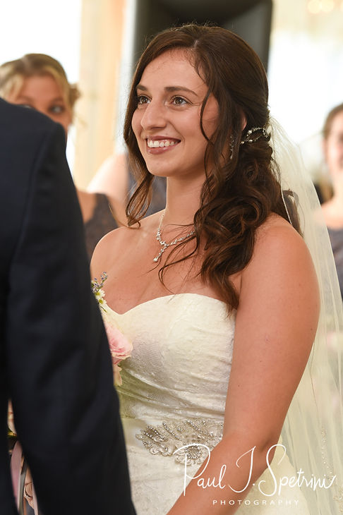 Karolyn smiles during her August 2018 wedding ceremony at a private residence in Sterling, Connecticut.