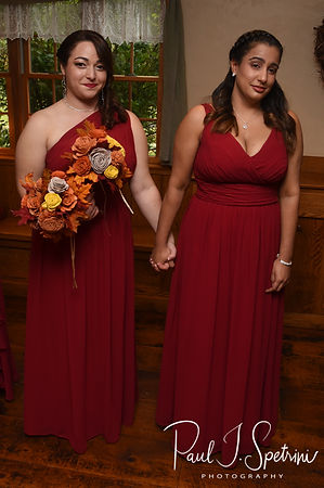 Two bridesmaids get emotional during Rich & Makayla's October 2018 wedding ceremony at Zukas Hilltop Barn in Spencer, Massachusetts.