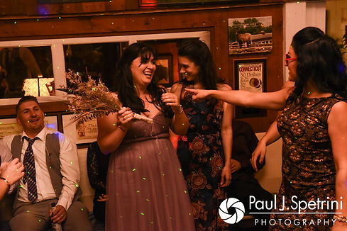 A guest catches the bouquet during Samantha and Dale's October 2017 wedding reception at the Golden Lamb Buttery in Brooklyn, Connecticut.