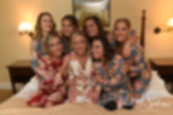 Nicole poses for a photo with her bridesmaids during her bridal prep session at the Publick House Historic Inn in Sturbridge, Massachusetts.