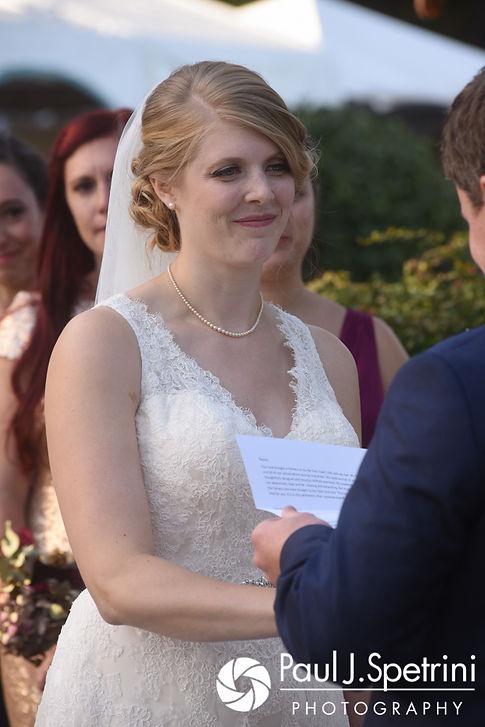 Rachel smiles during her October 2017 wedding ceremony at Castle Manor Inn in Gloucester, Massachusetts.