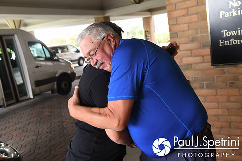Dallas and his father-in-law hug prior to his September 2017 wedding ceremony at the Crowne Plaza Hotel in Warwick, Rhode Island.