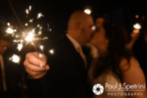 Meridith and Matthew kiss while holding sparklers following their May 2017 wedding reception at the Hope Artiste Village in Pawtucket, Rhode Island.