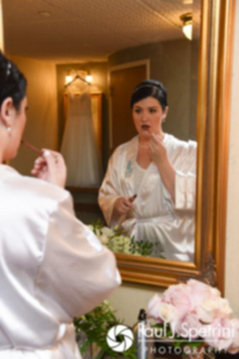 Allison applies lipstick prior to her September 2017 wedding ceremony at the Roger Williams Park Casino in Providence, Rhode Island.