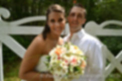 Holly and Damien smile for a formal photo during their August 2011 wedding