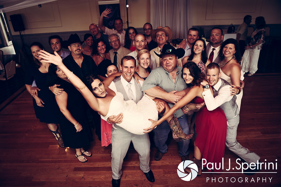 Heather and John pose for a group photo during their July 2016 wedding reception at Crystal Lake Golf Club in Burrillville, Rhode Island.