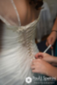 Gianna has her dress zipped prior to her July 2017 wedding ceremony at Peace Dale Congregational Church in South Kingstown, Rhode Island.