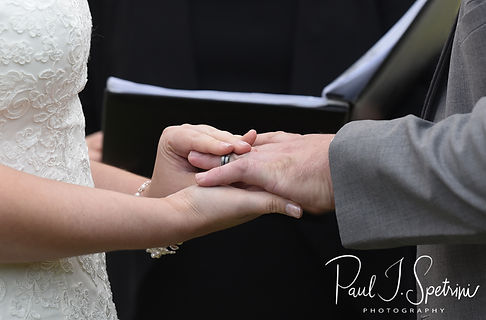 Justine and Jon exchange rings during their October 2018 wedding ceremony at Twelve Acres in Smithfield, Rhode Island.