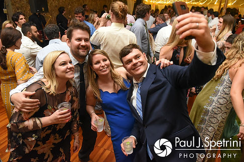 Guests pose for a selfie during Molly and Tim's June 2017 wedding reception at Farmhouse-By-The-Sea in Matunuck, Rhode Island.
