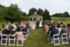 Stephanie and Jacob hold hands during their June 2018 wedding ceremony at Foster Country Club in Foster, Rhode Island.