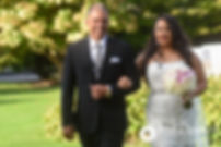 Stephany and her father walk down the aisle during her September 2017 wedding ceremony at Wannamoisett Country Club in Rumford, Rhode Island.