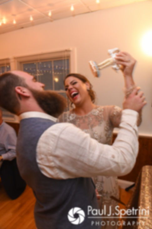 Arielle and Gary cut their wedding cake during their September 2017 wedding reception at North Beach Club House in Narragansett, Rhode Island.