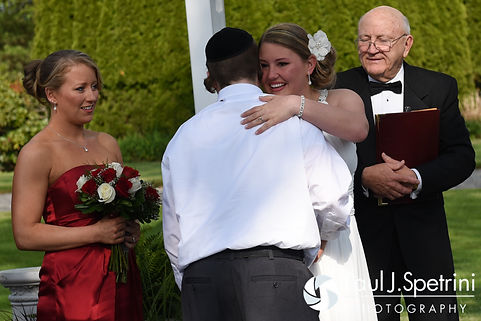 Latasha hugs a friend during her May 2016 wedding at Country Gardens in Rehoboth, Massachusetts.