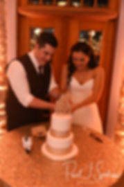 Nicole & Dan cut their wedding cake during their September 2018 wedding reception at The Towers in Narragansett, Rhode Island.