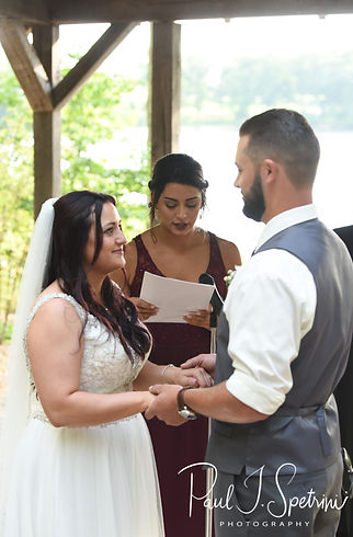 Lizzy and Gabe listen to a reading during their September2018 wedding ceremony at Crystal Lake Golf Club in Mapleville, Rhode Island.