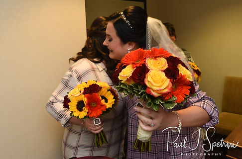 Justine and her cousin hug prior to her October 2018 wedding ceremony at Twelve Acres in Smithfield, Rhode Island.