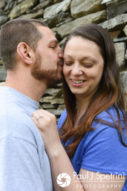 Jennifer and Kevin share a kiss during their May 2017 engagement session at Gillette Castle State Park in East Haddam, Connecticut.
