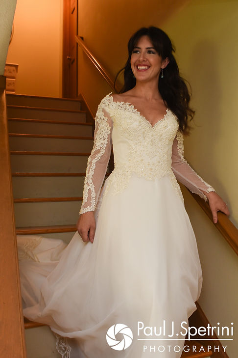 Samantha walks down the stairs prior to her October 2017 wedding ceremony at St. Robert's Church in Johnston, Rhode Island.