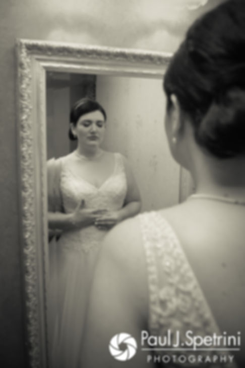 Allison takes a deep breath in her wedding dress prior to her September 2017 wedding ceremony at the Roger Williams Park Casino in Providence, Rhode Island.