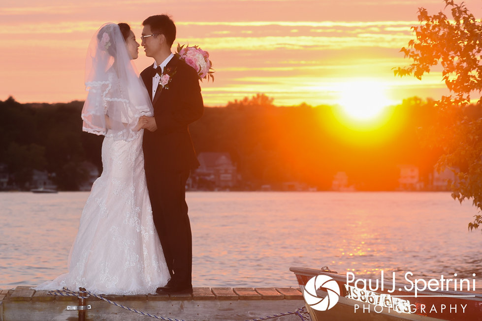 Cynthia and Ao pose for a formal photo following their August 2017 wedding ceremony at Lake Pearl in Wrentham, Massachusetts.
