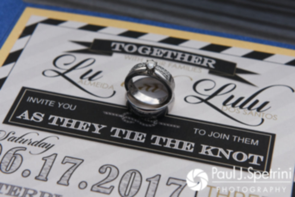 A look at Lucelene and Luis' wedding ring and invitation, shown during their June 2017 wedding reception at Al's Waterfront Restaurant in East Providence, Rhode Island.