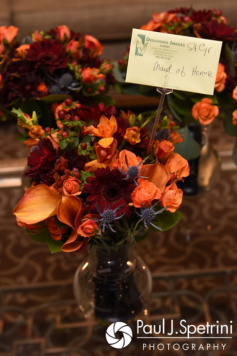 A look at the flowers, on display prior to Kristina and Kevin's October 2017 wedding ceremony at the Villa Ridder Country Club in East Bridgewater, Massachusetts.