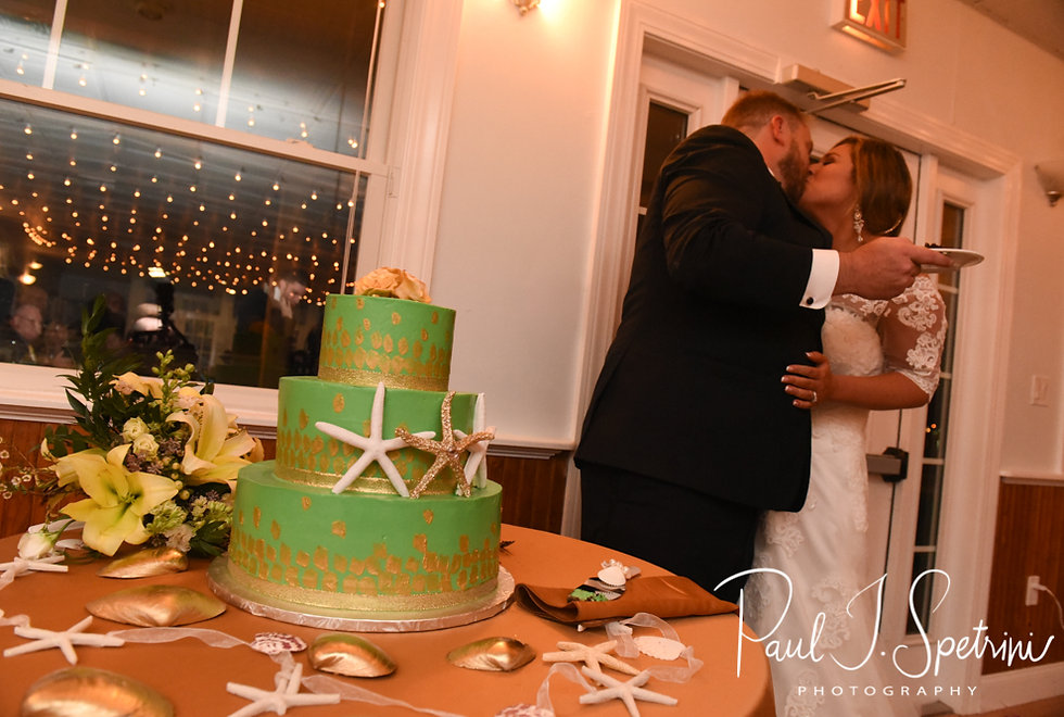Cara & Brandon kiss after cutting their wedding cake during their November 2018 wedding reception at the North Beach Clubhouse in Narragansett, Rhode Island.