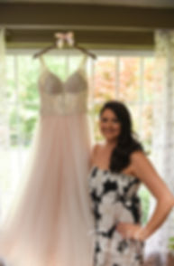Stephanie poses for a photo with her wedding dress prior to her June 2018 wedding ceremony at Foster Country Club in Foster, Rhode Island.
