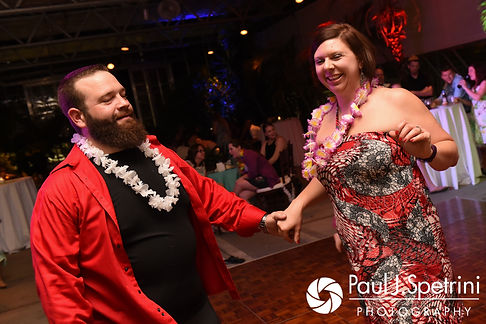 Guests dance during Will and Jess' May 2017 wedding reception at the Roger Williams Park Botanical Center in Providence, Rhode Island.
