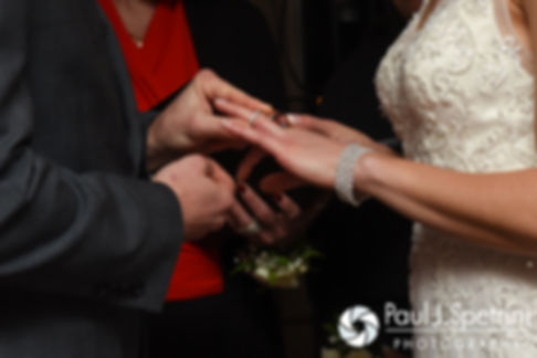 Gina and David exchange rings during their December 2016 wedding ceremony at the Waterman Grille in Providence, Rhode Island.