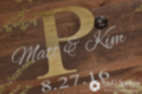 A look at the guestbook and rings on display during Kim and Matt's August 2016 wedding at Whispering Pines Conference Center in West Greenwich, Rhode Island.