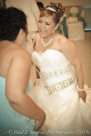 Jean Andrade dances during her wedding.