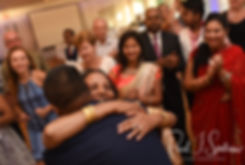 Jimmy and Saken dance with guests during their July 2018 wedding ceremony at Lake Pearl in Wrentham, Massachusetts.