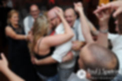 Eric and Michelle share a kiss during a group hug following their May 2016 wedding at Hillside Country Club in Rehoboth, Massachusetts.