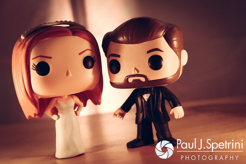 A look at the cake toppers, on display during JD and Brooke's October 2016 wedding reception at The Farm at SummitWynds in Jefferson, Massachusetts.