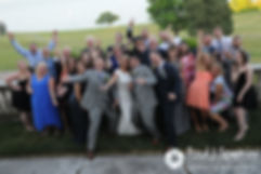 Amy and DJ pose for a large family photo during their June 2016 wedding reception at Aldrich Mansion in Warwick, Rhode Island.